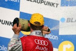 Podium: Mattias Ekström, Audi Sport Team Abt Sportsline, pulvérise du champagne