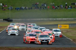 Rick Kelly and Jamie Whincup got the jump on Mark Skaife