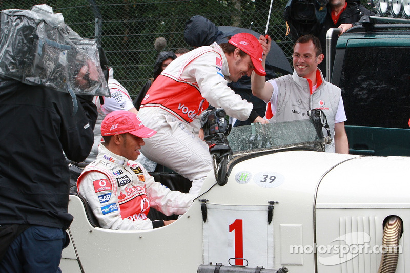 Fernando Alonso, McLaren Mercedes and Lewis Hamilton, McLaren Mercedes with a historic Mercedes S from 1927, in the rain