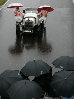 Fernando Alonso, McLaren Mercedes and Lewis Hamilton, McLaren Mercedes with a historic Mercedes S from 1927