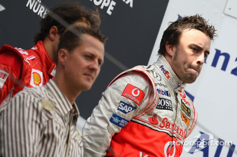 Podium: race winner Fernando Alonso with Michael Schumacher