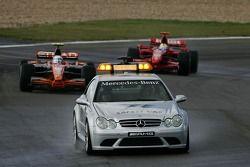 Markus Winkelhock, Spyker F1 Team, F8-VII and Kimi Raikkonen, Scuderia Ferrari, F2007 behind the saf