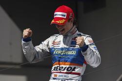 Javier Villa celebrates victory on the podium