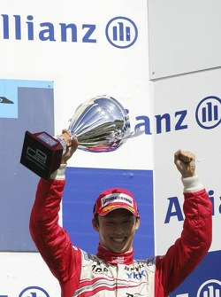 Kazuki Nakajima celebrates on the podium