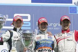 Javier Villa, Kohei Hirate and Kazuki Nakajima celebrate on the podium