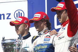Javier Villa celebrates victory on the podium with Kohei Hirate and Sakon Yamamoto
