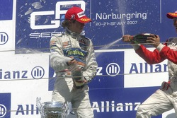 Javier Villa celebrates victory on the podium with Kazuki Nakajima