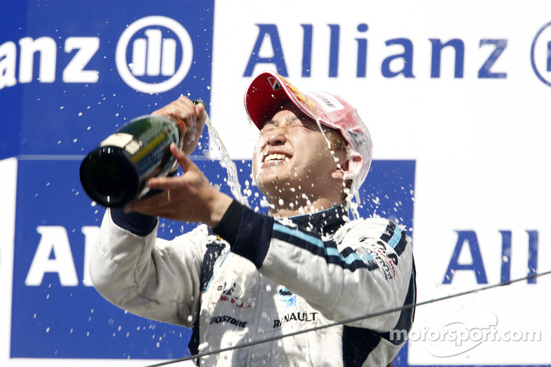 Kohei Hirate celebrates on the podium
