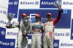Javier Villa celebrates victory on the podium with Kohei Hirate and Kazuki Nakajima