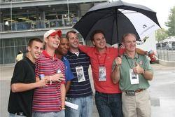 Fans pose