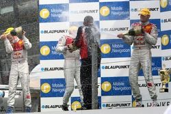 Podium: the Audi men on the podium spraying the champagne