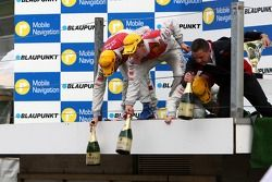 Podium: the Audi men on the podium drop down the champagne bottles for the teammembers