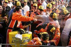 Victory lane: race winner Tony Stewart sprays champagne