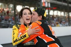 A surprised SprintSpeed Ambassador, Anne-Marie Rhodes, is kissed by race winner, Tony Stewart during post-race celebration