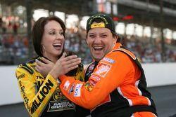 A surprised SprintSpeed Ambassador, Anne-Marie Rhodes, is kissed by race winner, Tony Stewart during post-race celebration
