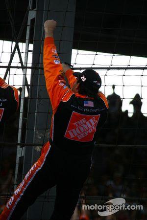 Race winner Tony Stewart climbs the fence