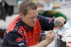 Car Chief, Ryan McKinney, makes adjustments to his 3M Ford Fusion