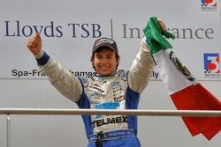 Sergio Perez waves the flag for Mexico