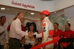 Lewis Hamilton, McLaren Mercedes, ve Tamas Kasas, water polo player cutting ribbon to open yeni Voda