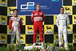 Podium: race winner Adam Carroll, second place, Kazuki Nakajima, third place Andreas Zuber