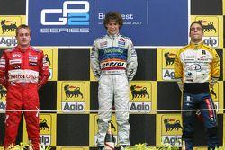 Podium: race winner Javier Villa, second, Adam Carroll, third, Roldan Rodriguez