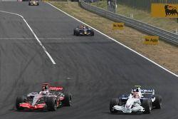 Fernando Alonso, McLaren Mercedes, MP4-22 passes Robert Kubica, BMW Sauber F1 Team, F1.07