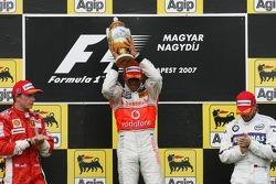 Podium: race winner Lewis Hamilton with second place Kimi Raikkonen and third place Nick Heidfeld