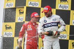 Podium: second place Kimi Raikkonen and third place Nick Heidfeld