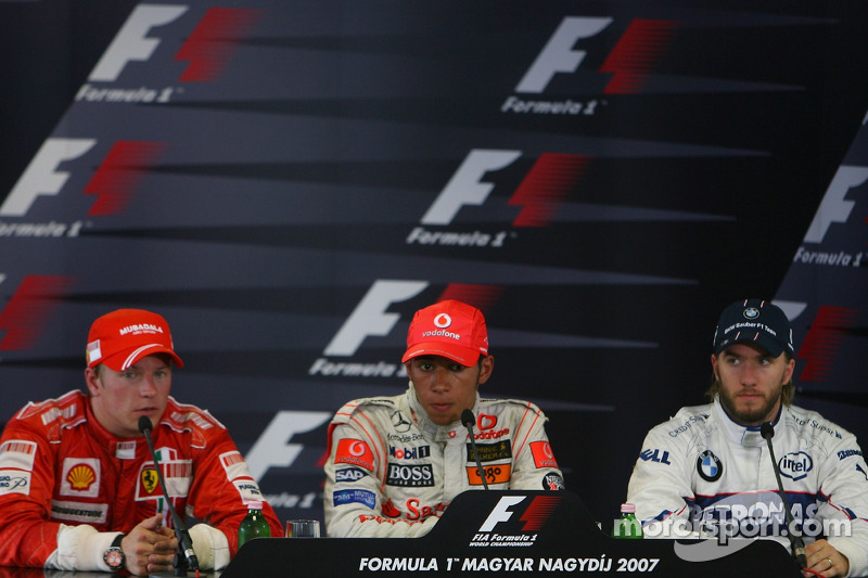 Press conference: race winner Lewis Hamilton with second place Kimi Raikkonen and third place Nick H
