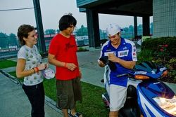 Ben Spies shares an autograph and a smile with two young fans