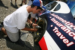 A fan tries wheel changing at the pit crew challenge