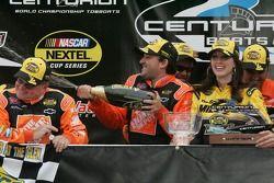 Victory lane: race winner Tony Stewart celebrates