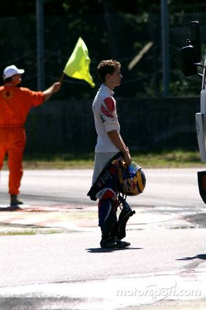 Waiting at the bus stop: unlucky Tom Dillmann, after gently parking his car on the gravels