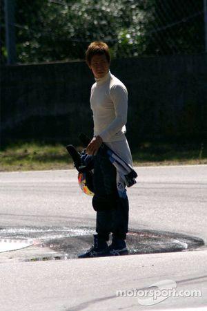 Incredulous Kamui Kobayashi, measuring the distance of his flight into the same gravels