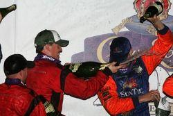 Podium: champagne for race winners Alex Gurney and Jon Fogarty