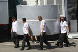 McLaren Mercedes team members carrying part of their motorhome