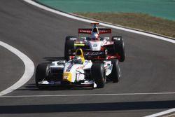 Lucas di Grassi leads Adam Carroll
