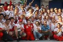 Race winner Felipe Massa celebrates with Kimi Raikkonen, Jean Todt and Scuderia Ferrari team members