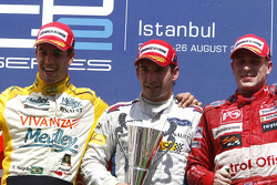 Timo Glock celebrates his victory on the podium with Xandi Negrao and Adam Carroll