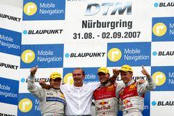 Podium: race winner Martin Tomczyk, second place Mattias Ekström, third place Bruno Spengler