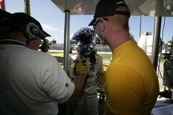 GT pole winner Jan Magnussen celebrates with Johnny O'Connell and Corvette Racing team members