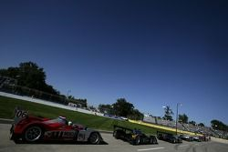 Prototype cars await the start of the qualifying session on pitlane