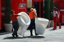 Workers bring items padok