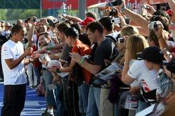 Lewis Hamilton, McLaren Mercedes signing autographs to the fans