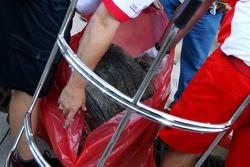 Bridgestone take away tyres from the crash damaged car of Kimi Raikkonen, Scuderia Ferrari