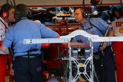 The FIA Examine the car of Kimi Raikkonen, Scuderia Ferrari, F2007, after he crashed heavily in Free Practice 3