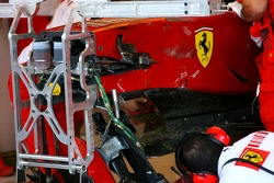 Scuderia Ferrari rebuild the car of Kimi Raikkonen, Scuderia Ferrari, F2007, after he crashed heavily in Free Practice 3