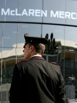 A police officer outside McLaren Mercedes