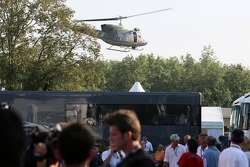A helicopter is taking off behind the paddock