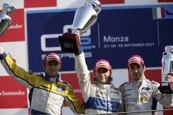 Giorgio Pantano celebrates victory on the podium with Luca Filippi and Timo Glock